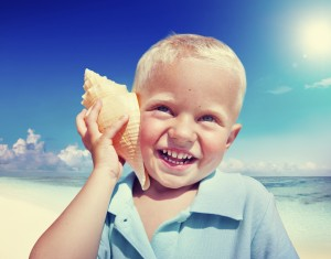 Little Boy Beach Seashell Fun Vacation Concept